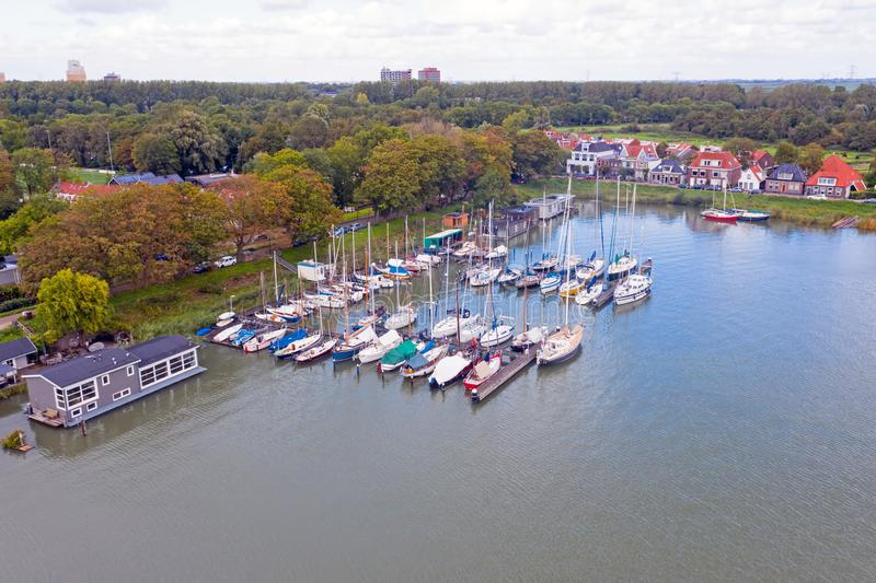 Aerial from historical dutch houses, house boats and sailing yachts in the countryside from the Netherlands stock image