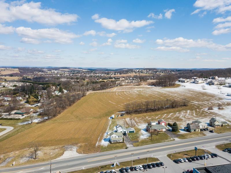 Aerial of Homes and Farmland in Red Lion, Pennsylvania in York C. Ounty stock photography