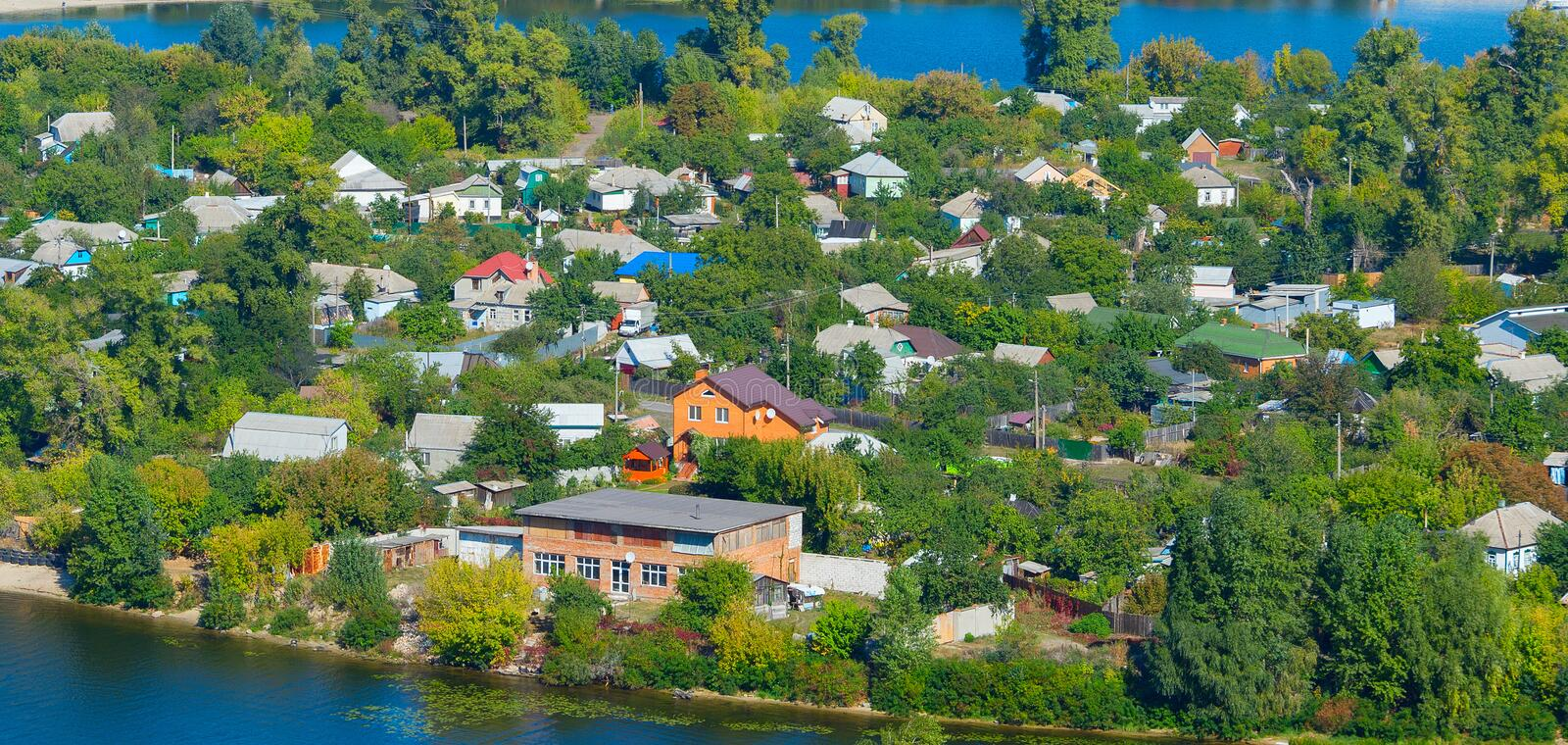 Aerial houses Dnipro river Kyiv. Private housing area on green peninsula at Dnieper river. Kiev, Ukraine stock images