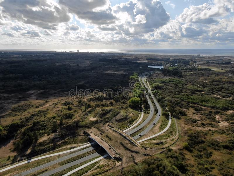 Aerial image of ecoduct crossing highway in dunes national park in the Netherlands. Aerial image shot by drone of ecoduct crossing highway in dunes national park stock images