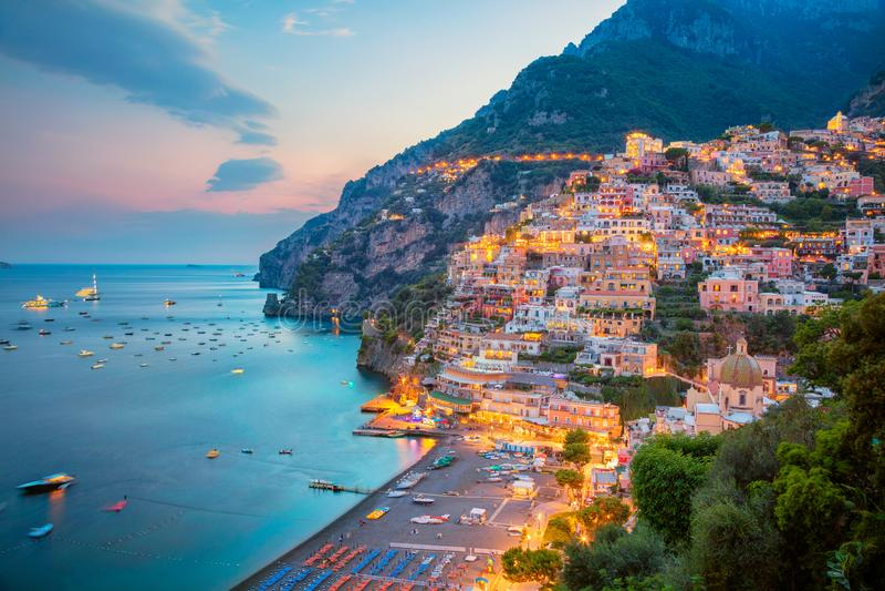 City of Positano, Italy. Aerial image of famous city Positano located on Amalfi Coast, Italy during sunset stock photography