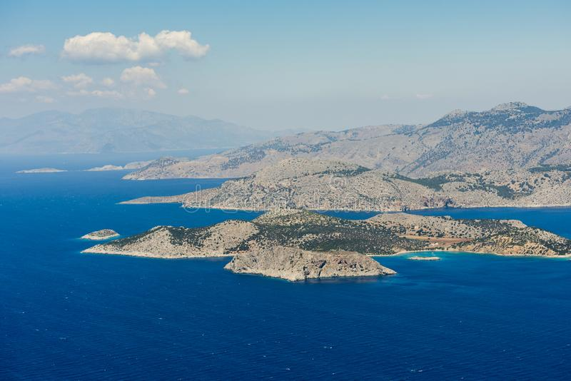 Aerial image of Greek islands Koulondros and Seskli. Aerial image of eastern Dodecanese Greek islands Koulondros, Seskli and Xisos in the Mediterranean Sea royalty free stock photography