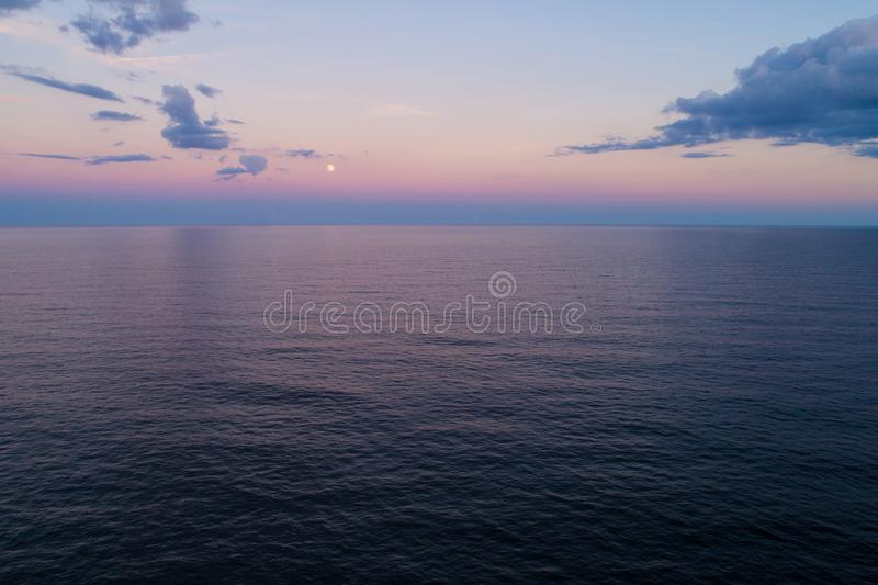 Aerial image moon over the ocean royalty free stock photos