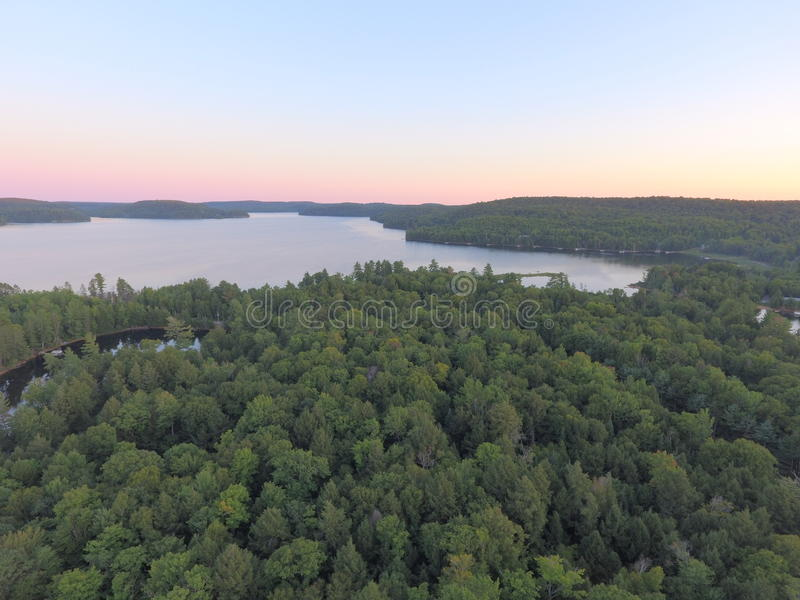 Aerial Lake and Forest Sunset View in Haliburton Highlands royalty free stock images