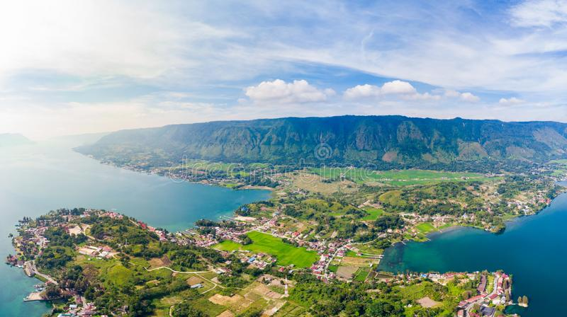 Aerial: lake Toba and Samosir Island view from above Sumatra Indonesia. Huge volcanic caldera covered by water, traditional Batak royalty free stock photography