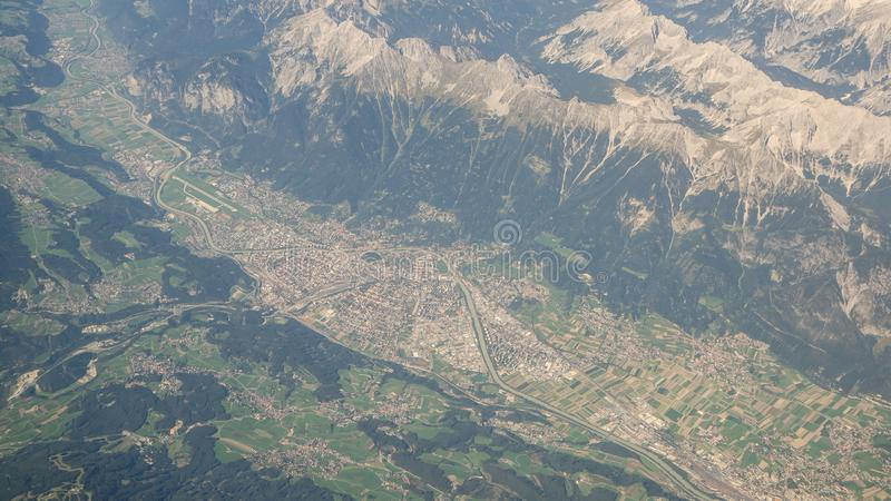 Aerial landscape at the city of Innsbruck Austria from the airplane window. Summer time royalty free stock photos