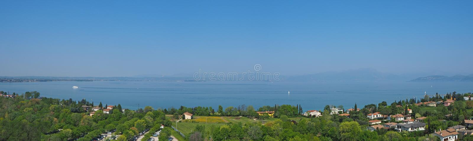Aerial landscape of Lake Garda and its hills blue water and green meadows contrast stock photography
