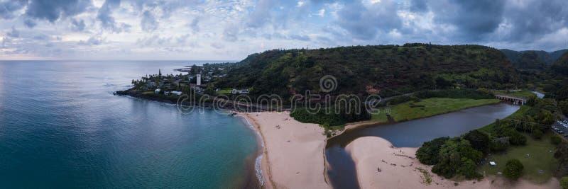 Waimea Beach Park Landscape Panorama. Aerial, landscape panorama of Waimea Bay Beach Park on Oahu, Hawaii north shore, shown with moody, cloudy sky near sunset stock photo