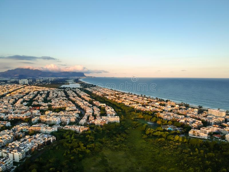 Aerial landscape photo of Recreio dos Bandeirantes beach during sunset, with views of Chico Mendes park stock image