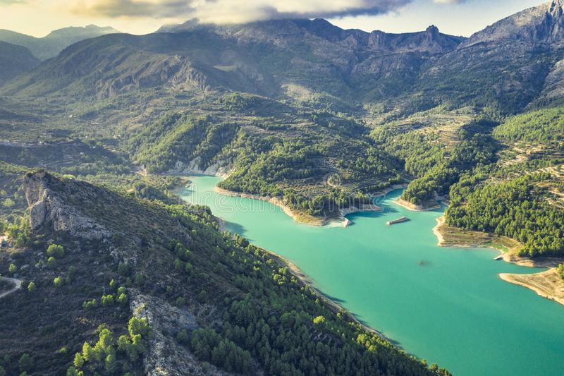 Aerial landscape shot of Guadalest Lake Valley Alicante Province Costa Blanca Spain at sunset.  stock photo
