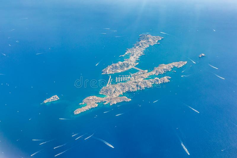 Aerial landscape of small island with sailboats and speedboats close to coast of French Riviera. Cannes aerial view. Cote d`Azur, French Riviera from sky. Monte stock images