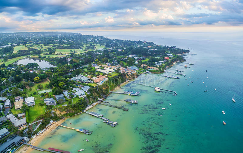 Aerial landscape of Sorrento suburb coastline with private piers. And moored boats at sunrise. Mornington Peninsula, Melbourne, Australia royalty free stock photo