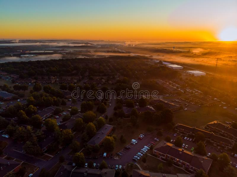 Aerial landscape of streets and residential area a height view from above panorama sunrise with fog royalty free stock photos