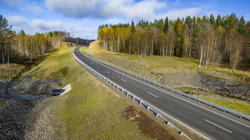 Aerial landscape view of empty rural road in beautiful autumn forest stock image