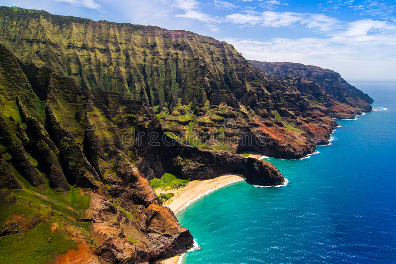 Aerial landscape view of Honopu Arch at Na Pali coastline, Kauai royalty free stock images