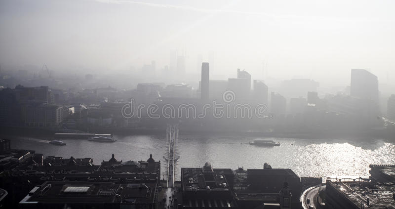 Aerial London view on a foggy day from St Paul`s cathedral stock photography