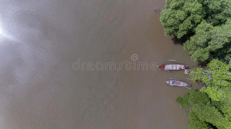 Aerial long tail boat with mangrove forest in South of Thailand royalty free stock image