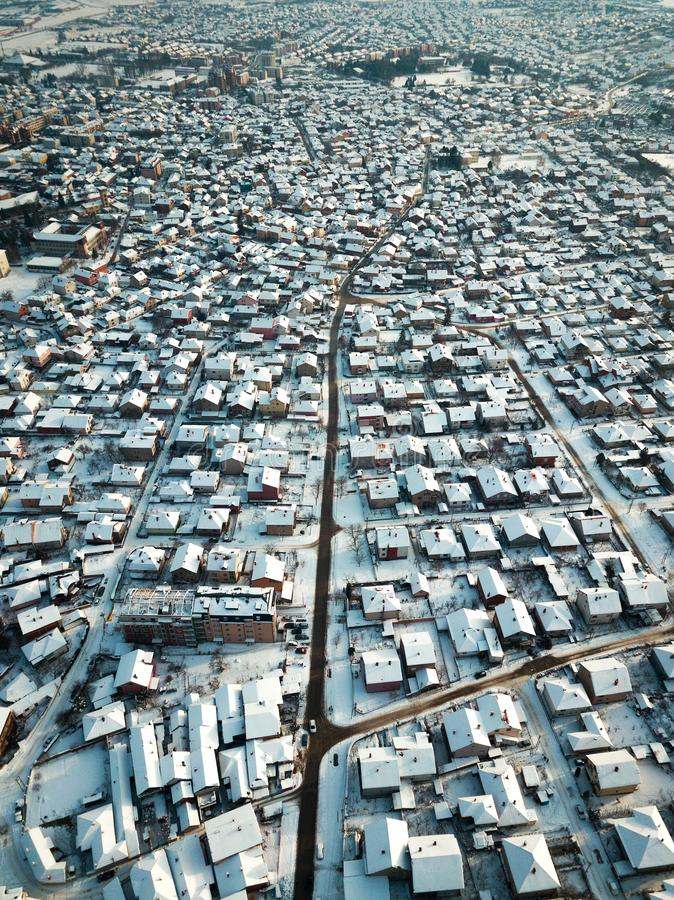 Aerial of rooftops covered with snow stock images