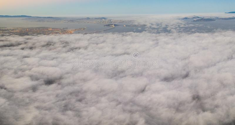 Aerial of Marine Layer Drifting Over San Francisco Bay Area. The ever-present offshore marine layer in California is propelled inland in the San Francisco Bay royalty free stock photo