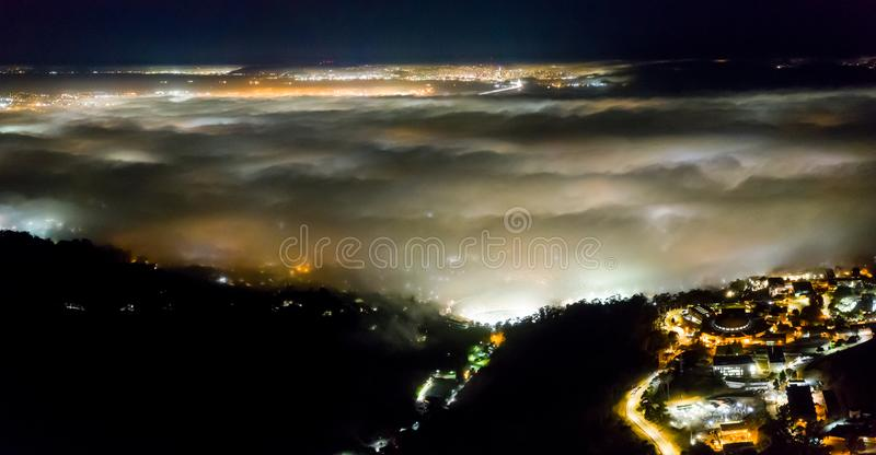 Aerial of Marine Layer Flowing Over Bay Area, California. At night the ever-present offshore marine layer in California is propelled inland in the San Francisco royalty free stock photography