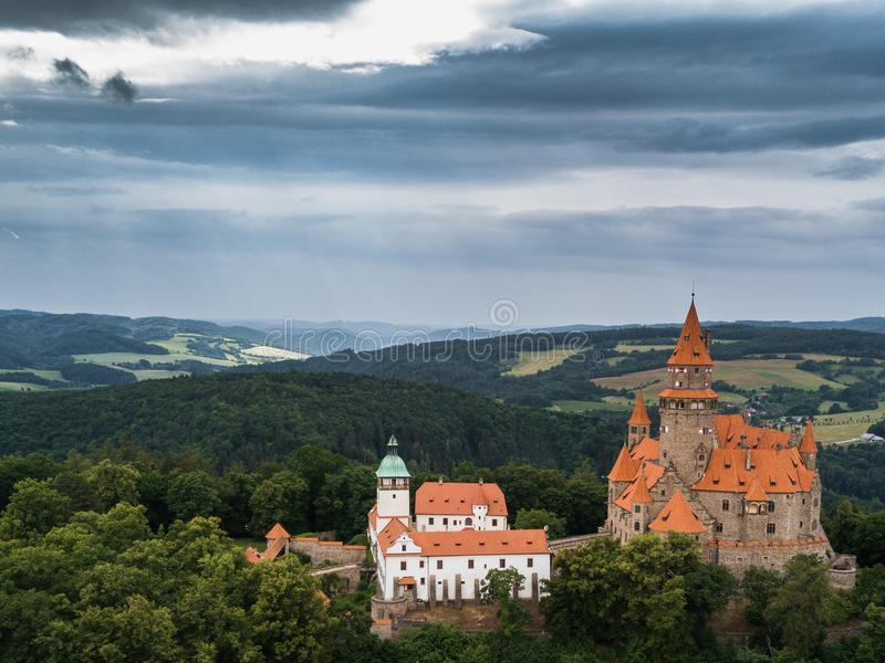Aerial of medieval castle on the hill in Czech region of Moravia. Aerial of medieval Bouzov castle on the hill in Czech region of Moravia royalty free stock photo