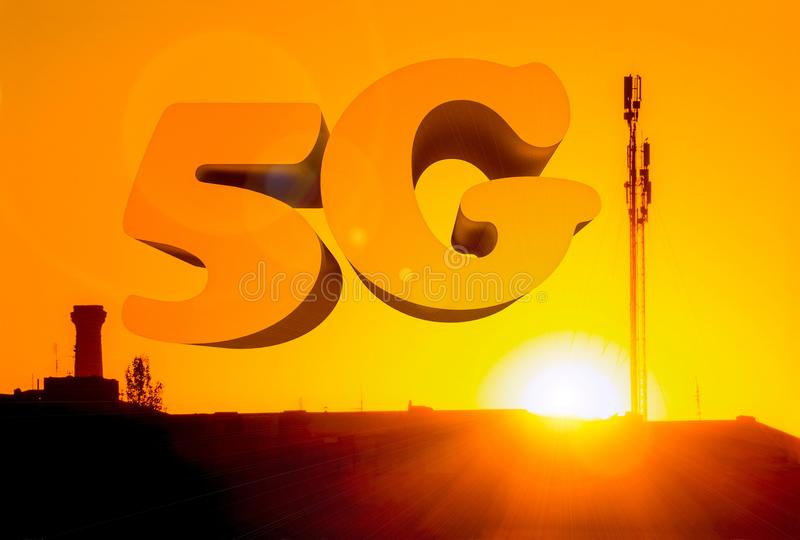 Aerial of mobile communication on a background of a bright sunset. Sihoulette of High antenna. Sun rays and glare. The inscription. Is 5G. The concept of mobile stock photo