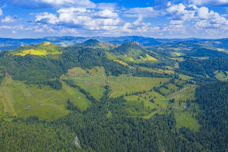 Aerial mountain pasture in a summer landscape. From drone, flying, flight, high, meadow, field, green, valley, outdoor, view, photo, over, environment, nature royalty free stock photography