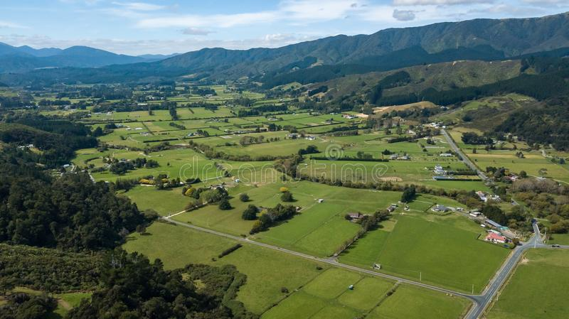 Aerial, New Zealand Farmlands In Hutt Valley. Beautiful Upper Hutt farmlands in between two mountains stock photos
