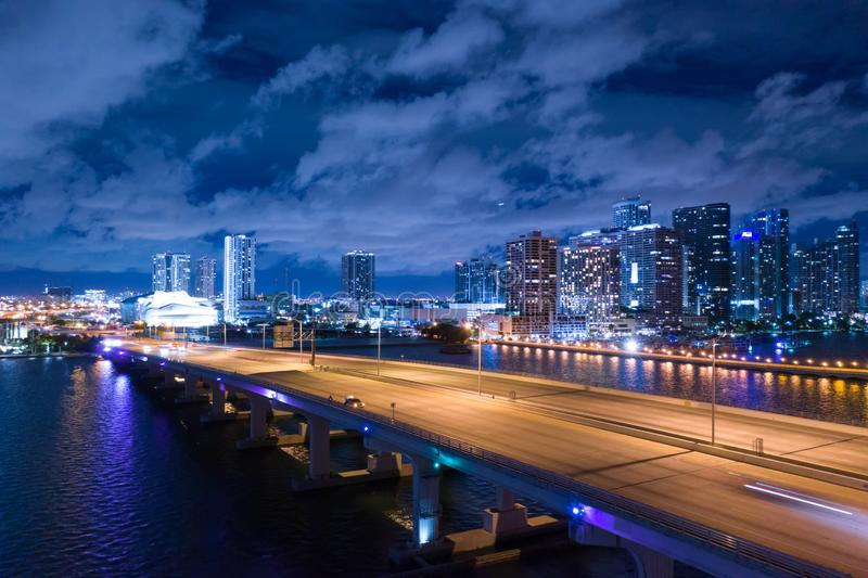 Aerial night photo of the Macarthur Causeway Downtown Miami over Biscayne Bay stock photo