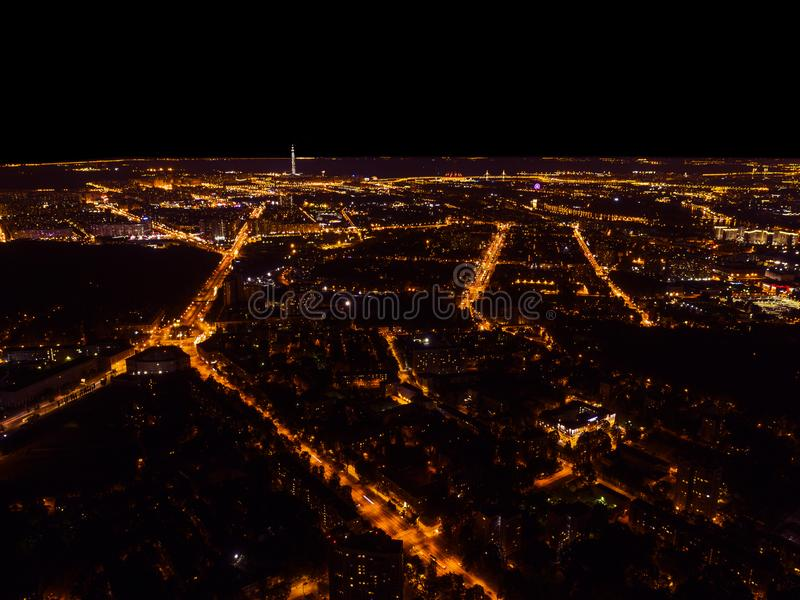 Aerial night view of a big city. Beautiful cityscape panorama at night. Aerial view of buildings an roads with car in the city at royalty free stock photo