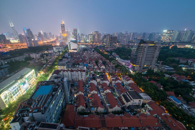 Aerial Night View During the Blue Hour of Modern and Old Buildings of Downtown Shanghai, China. Shanghai, on China's central coast, is the country`s royalty free stock photo