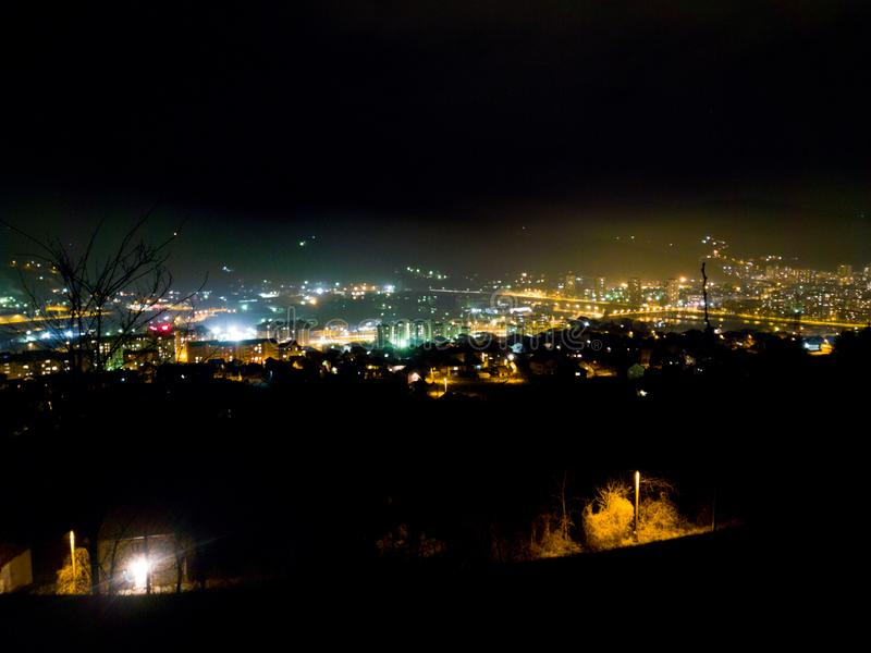 Zenica at night. Aerial night view of the city of Zenica located in Bosnia-Herzogovina in southeastern Europe royalty free stock images