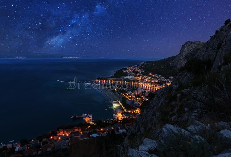 Aerial night view of Omis and Adriatic sea, Croatia royalty free stock photo