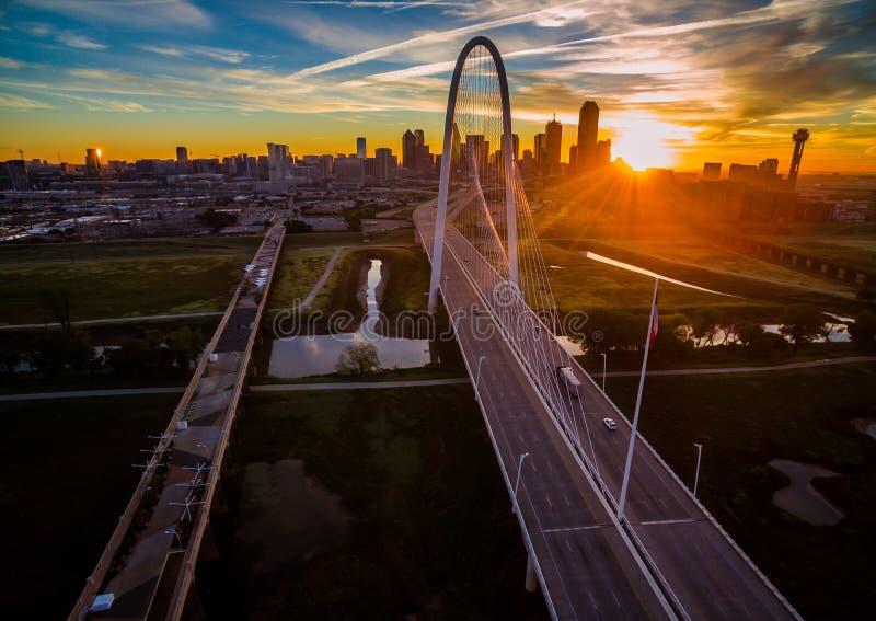 Aerial Over Bridges Dallas Texas Dramatic Sunrise Margaret Hunt Hill Bridge and Reunion Tower. Aerial Over Bridges dramatic sunrise pink clouds with City lights stock photo