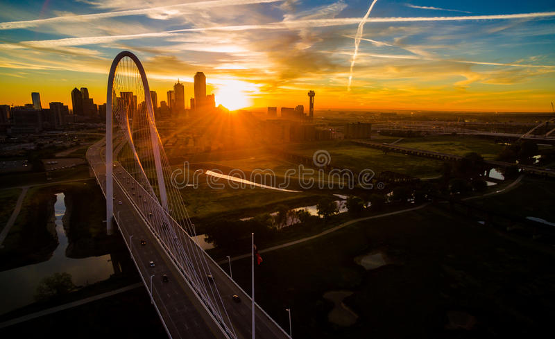 Aerial Over Bridges Solar Flare Sunrise Dallas Texas Dramatic Sunrise Margaret Hunt Hill Bridge and Reunion Tower. Aerial Over Bridges Solar Flare Sunrise royalty free stock photo