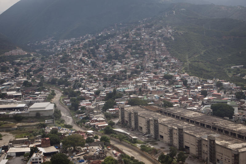 Aerial over slums of Caracas, Venezuela. Aerial view over crowded slums in Caracas, Venezuela in South America on sunny day royalty free stock photo