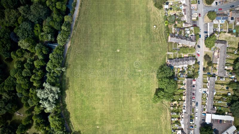 Aerial overhead shot of grass field at daytime stock image