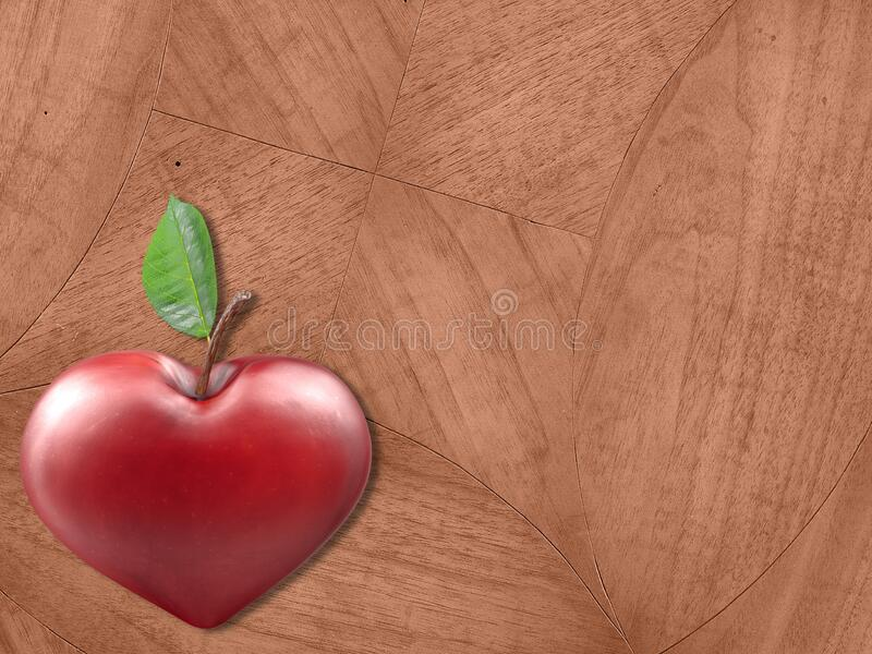 Heart shaped apple from above. Aerial / overhead view of a heart shaped apple lying on a wooden table top / work surface stock photos