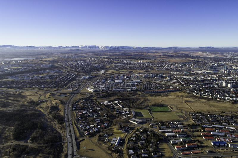 Aerial overlooking kopavogur suburb in Reykjavik Iceland. Aerial photograph overlooking Kopavogur town, a suburb of Reykjavik, the capital of Iceland. Mountains stock photo