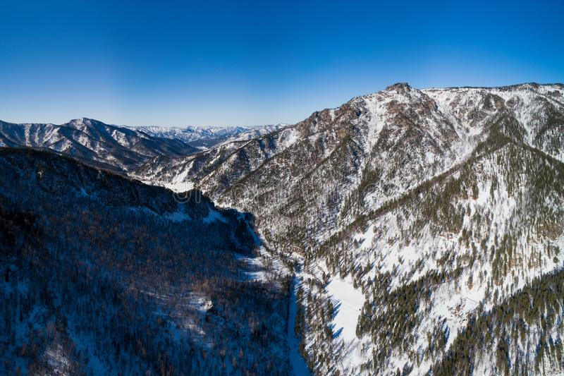 Aerial pano of winter mountain stock photography