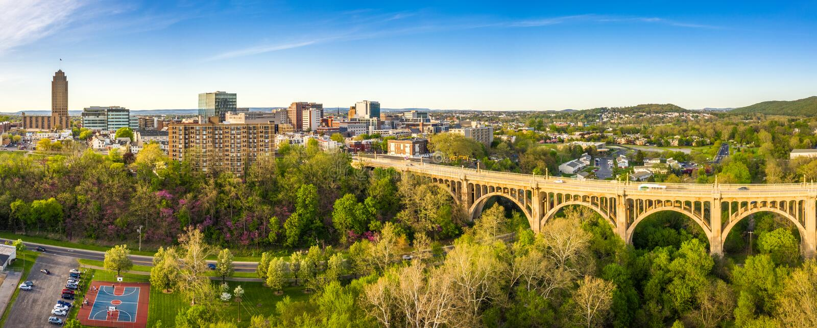 Aerial panorama of Allentown, Pennsylvania skyline. And Albertus L. Meyers Bridge aka Eighth Street Bridge on late sunny afternoon . Allentown is Pennsylvania`s royalty free stock images