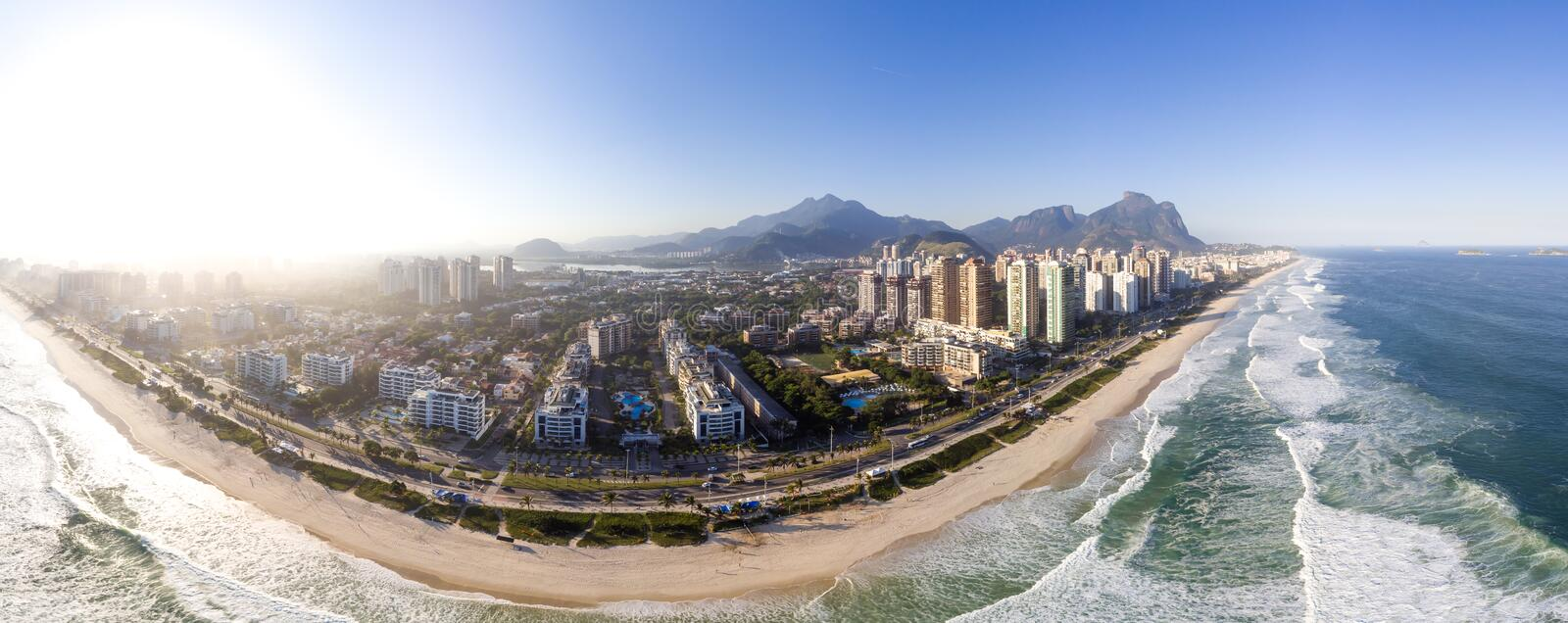 Aerial panorama of Barra da Tijuca beach during late afternoon. Rio de Janeiro, Brazil. Aerial view of Barra da Tijuca beach during sunset, golden light. Rio de royalty free stock photos
