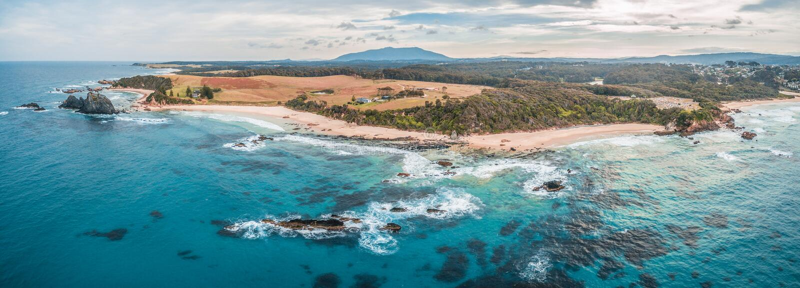 Aerial panorama of beautiful rugged coastline at Narooma, New South Wales, Australia. royalty free stock photography
