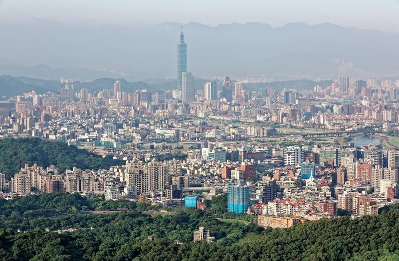 Aerial panorama of busy Taipei City with view of Taipei 101 Tower in downtown area, Keelung River and distant Mountains in morning stock photos