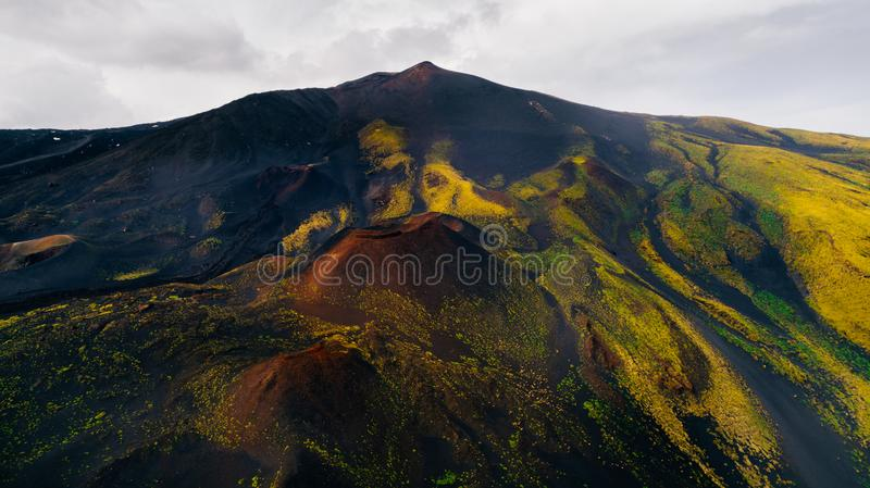 Aerial panorama of collapsed volcano cone, Mount Etna, Sicily, Italy.Aerial photo Mount Etna volcanic crater, scenic volcanic stock photography