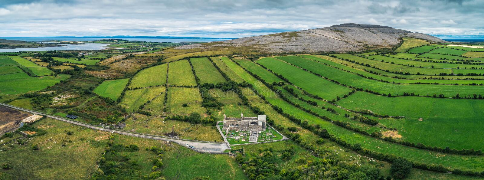 Aerial panorama of Corcomroe Abbey ruins and its cemetery. Located in the Burren region of County Clare, Ireland stock images