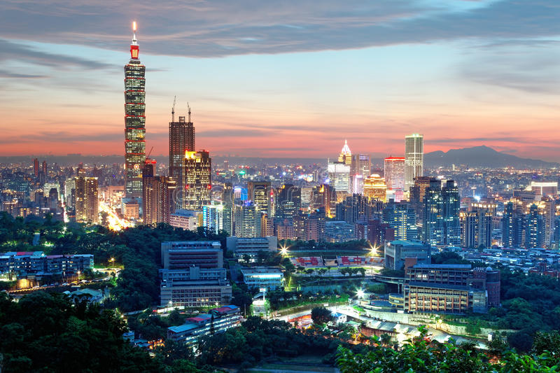 Aerial panorama of Downtown Taipei City with Taipei 101 Tower among skyscrapers under dramatic sunset sky. ~ A romantic evening in Taipei, capital city of stock images