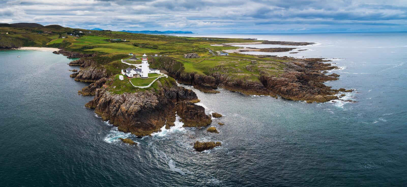 Aerial panorama of the Fanad Head Lighthouse in Ireland. Aerial panorama of the Fanad Head Lighthouse located on the north coast of County Donegal in Ireland royalty free stock image