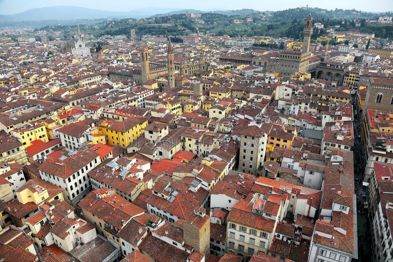 Aerial panorama of Florence old town from the top of Florence Cathedral Il Duomo di Firenze with a view of crowded houses stock image