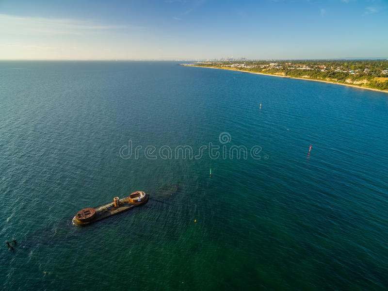 Aerial panorama of historic shipwreck of HMVS Cerberus at sunset. Aerial panorama of historic shipwreck of HMVS Cerberus near the shore of Black Rock suburb at stock image